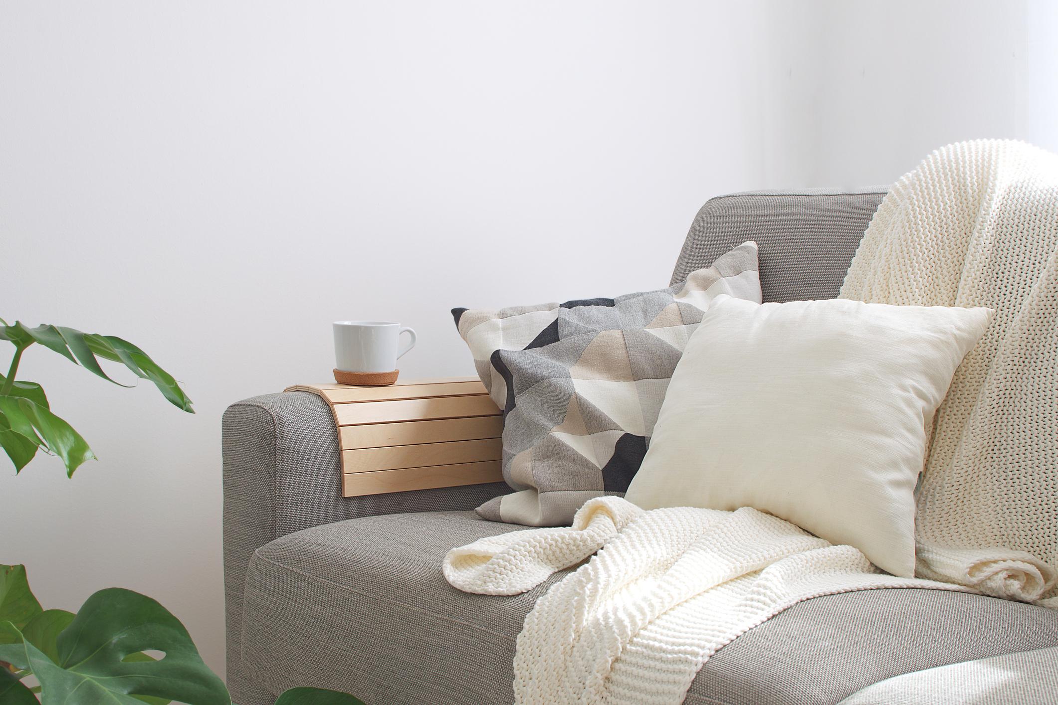 Home interior Cozy Living room Sofa Cushion Coffee mug Knitted plaid Monstera plant Room decor Scandinavian style Copy space